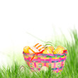 Colorful painted easter eggs in a basket