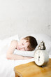 Boy sleeping 4 years. Focuse old clock.
