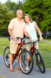 Senior couple cycling.