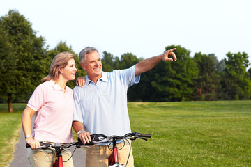 Senior couple cycling.