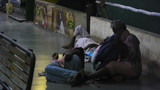 Men sleeping on a street floor