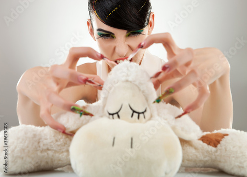woman killing her teddy bear