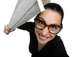 Funny girl in glasses with a newspaper