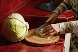 Woman hands cutting cabbage
