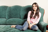 Brunette on green sofa