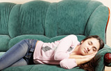 Brunette napping on green sofa