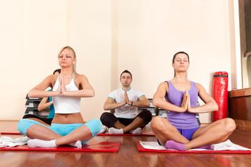 Young people practice yoga