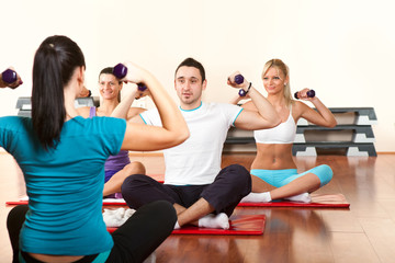 Fitness group of people with lifting dumbbell