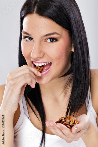 young woman eating nut