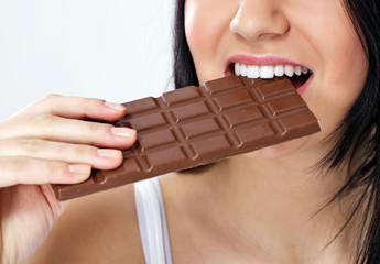 woman eating  chocolate