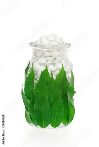Herbal supplement pills in pill bottle – alternative medicine