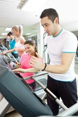man using treadmill at gym