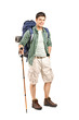 Full length portrait of a hiker with backpack and hiking poles p