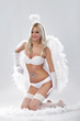 Young blond woman as angel