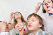 children friends blowing bubbles