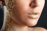 Close up portrait of golden lips.