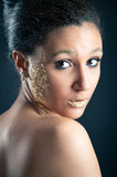 Portrait of beautiful girl with golden makeup and lips.