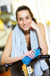 Portrait of a relaxed attractive young woman after exercise