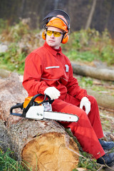 Lumberjack Worker With Chainsaw In The Forest