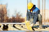 construction worker preparing formwork poster