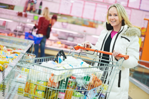 woman at supermarket dairy shopping
