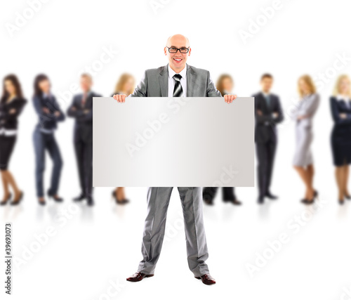 Succesfull business man and group holding a banner