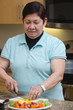 Senior asian filipino woman preparing food