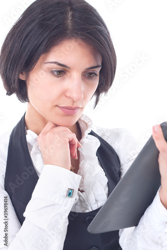 woman holding tablet computer. working on touching screen.
