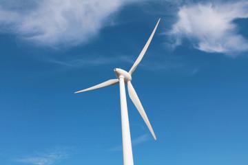 Windturbine against blue sky
