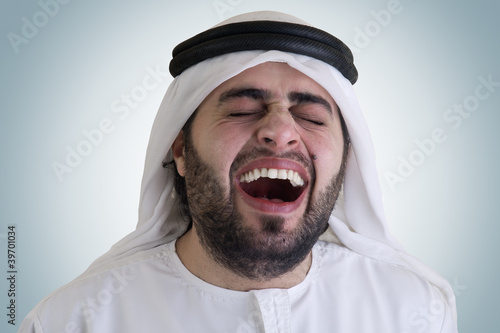 arabian man laughing - clipping path included for isolation