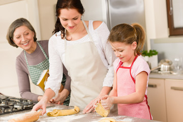 Three generation of women baking dough kitchen