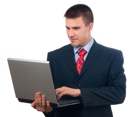 Attractive young businessman working on notebook