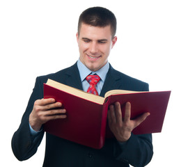 Smiling handsome businessman reading the book