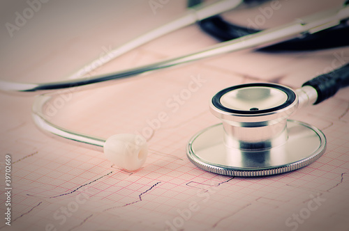 medical stethoscope on electrocardiogram (ECG) close up