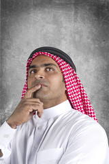 traditional arabian businessman thinking with space for text