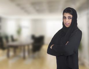 arabian business executive woman wearing hijab posing in office