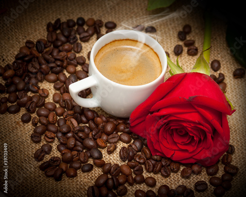 Wonderful cup of hot coffee and red rose
