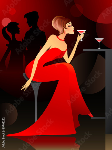 Woman having cocktail at the bar