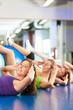 Fitness - Training mit Ball im Fitnessstudio