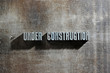 Image of a Under Construction sign, metal background
