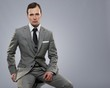 Businessman isolated on grey background.