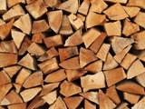Fototapety Holzscheite als Brennholz übereinander gestapelt