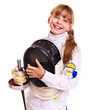 Child in fencing costume holding epee .