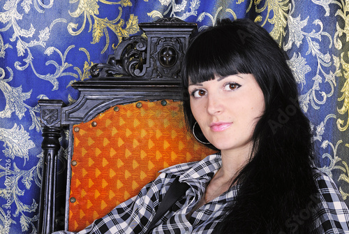 making look younger beautiful girl brunette in easy chair