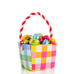 milk chocolate easter eggs in a cheerful checked basket isolated