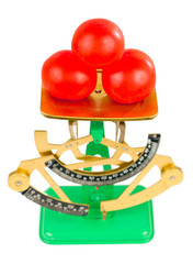 Three tomatoes and scales
