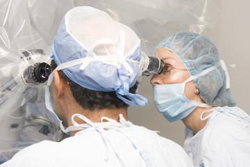 Group Of Surgeons Using Operating