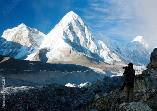 photographer on mountains - hiking in Nepal