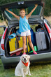 Kid with dog ready for the travel for summer vacation