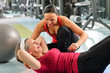 Senior woman exercise abdominal in fitness center - 39727445